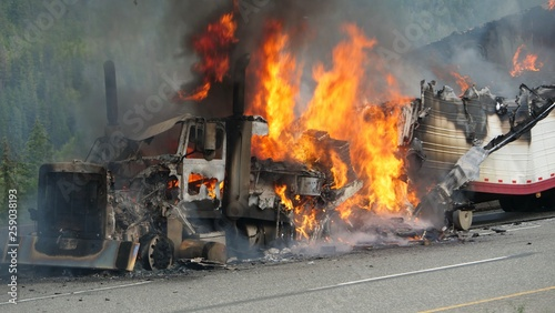 Photographie A semi truck burns out of control on a highway