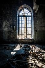 Old Broken Lancet Window Inside Abandoned Building