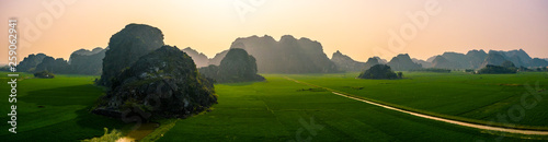 Photo  Aerial drone photo - Mountains and rice fields of North Vietnam at sunset