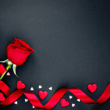 Beautiful Valentines Day Background With Red Roses And Hearts On Black Background. Flat Lay, Copy Space