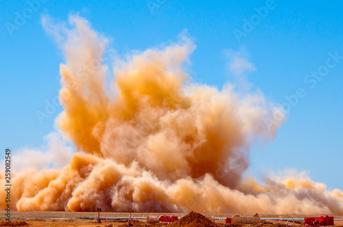Tablou Canvas Rock dust clouds after the detonator blast on the mining site