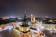 Leinwanddruck Bild - Aerial drone view Cracow old town and city main square at night.