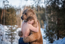 Half-naked Man Hugs A Brown Be...