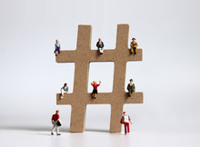 Hashtag And Variety Of Miniature People.