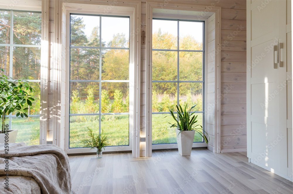 Fototapeta Bright interior, room in wooden house with large window. Scandinavian style.