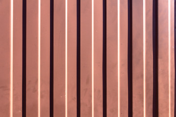 Brown dirty metal background with vertical lines pattern