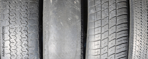 Fototapeta worn out bald old car tire close-up obraz
