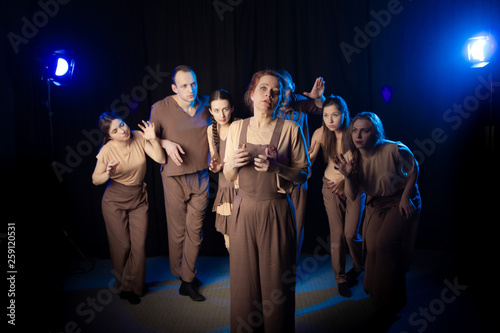 The actors on the stage play an emotion performance on a black background in sta Canvas Print