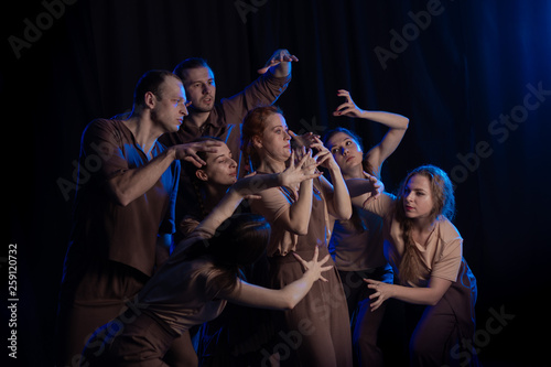 Photo  The actors on the stage play an emotion performance on a black background in sta