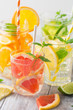 Infused water with fresh citrus fruits and ice