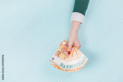 Fotografia  Female hands with cash, euro banknotes.
