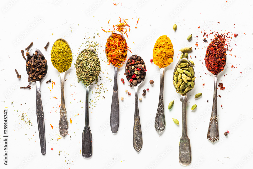 Fototapety, obrazy: Set of indian spices in spoons on white