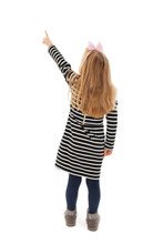 Back View Of Little Girl Points At Wall. Rear View. Isolated On White Background