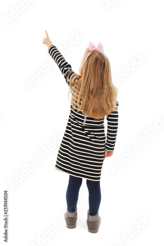 Fotomural Back view of little girl points at wall