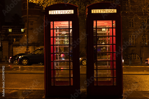London phone booth duo at night Canvas Print