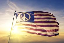 US Peace Flag Waving On The Top Sunrise Mist Fog