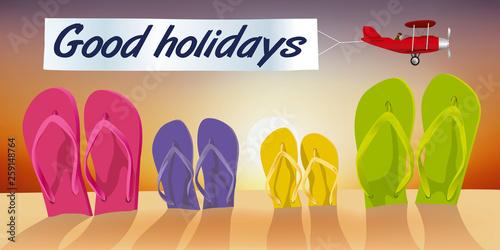 Valokuvatapetti Concept des vacances à la plage, avec des tongs plantées dans le sable et un avion qui passe devant un coucher de soleil en tirant une banderole sur laquelle est écrit bonnes vacances