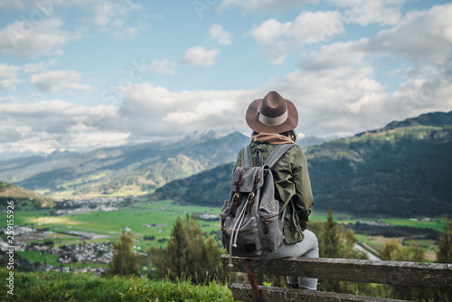 Foto auf Leinwand Akt Young woman with a backpack outdoors