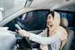 portrait of asian muslim woman with hijab driving a car