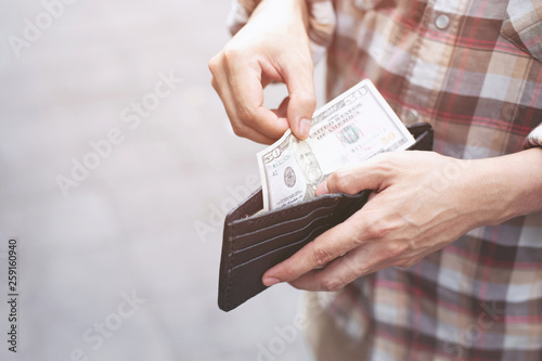 Valokuva  Businessman Person holding an wallet in the hands of an man take money out of pocket