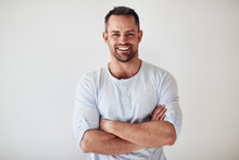 Mature Entrepreneur Standing With Arms Crossed On A White Backgr