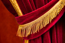Close Up Detail Of Open And Ruffeld Red Curtain With Golden Fringes Tassel With Blurred Background - Concept Theater Stage Elegance Show Entertainment Event Textile Material Luxury Open Right Side