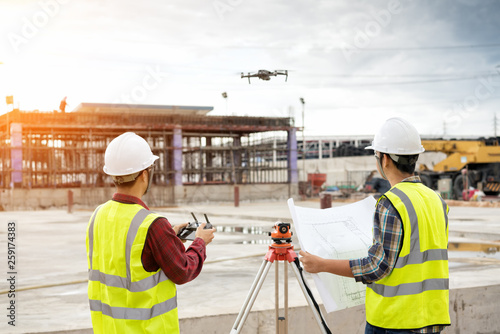 Valokuva  Engineer surveyor working with theodolite at construction site