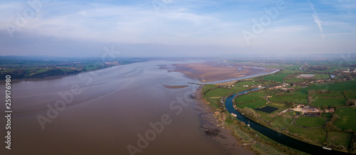 Valokuva  Aerial view of the Historic tidal river bank erosion protection scheme at Purton