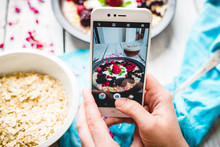 Hands Hold The Phone, Photographing Colorful, Healthy Food On A Light Wooden Table