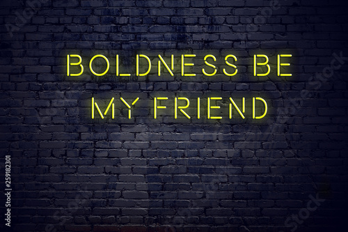 Positive inspiring quote on neon sign against brick wall boldness be my friend Wallpaper Mural