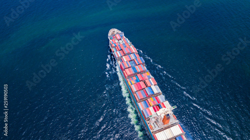 Fototapeta  Cargo ships with full container receipts to import and export products worldwide