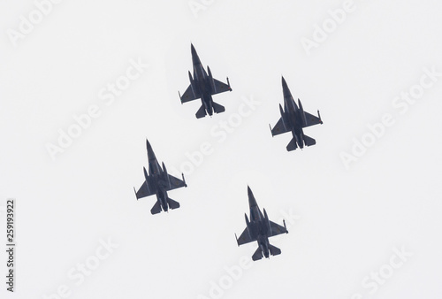 Fotografija  Formation of modern fighter jets in flight equipped with bombs and missiles ready to attack