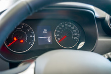 Modern Car Instrument Panel And Dashboard With Red Speedometer Needle  Showing Open Doors And Hand Brake On The Display.