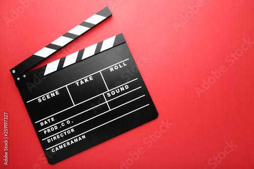 Valokuvatapetti Clapper board on red background