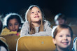 canvas print picture - selective focus of cute smiling child watching movie together with multicultural friends