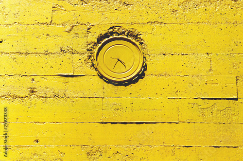 clock on the uellow wall
