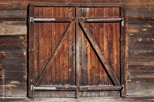 Grunge wooden barn door. Rustic vintage desk construction background.