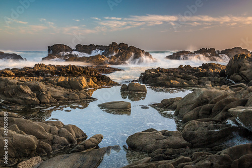 Poster Cote Tidal pools with rocks and waves of the ocean