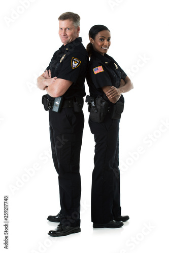 Fototapeta Police: Two Officers Stand Back To Back