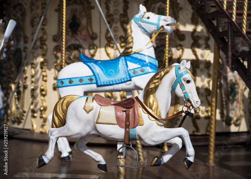 Valokuva  A white wooden horse on a merry-go-round