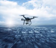 Modern Dark Drone In Flight Over The City.