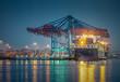 canvas print picture - Containerschiff im Hafen von Hamburg bei Nacht