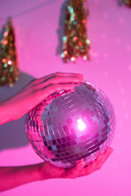 Close Up Of Woman Holding Disco Ball