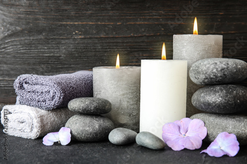 Aluminium Prints Spa Composition with zen stones, towels and candles on table against wooden background