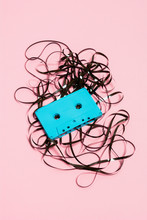 Blue Cassette With Messy Tape