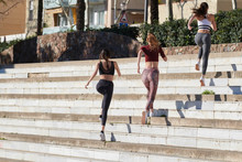Active Sportswomen Running On ...