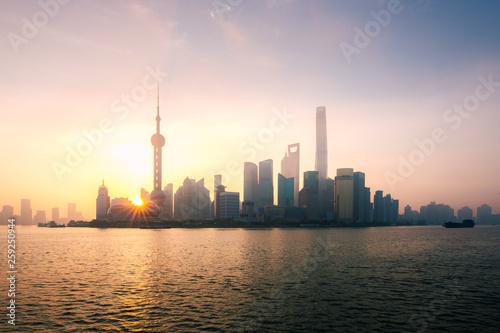 Valokuvatapetti Shanghai, China city skyline during sunrise on the Huangpu River.