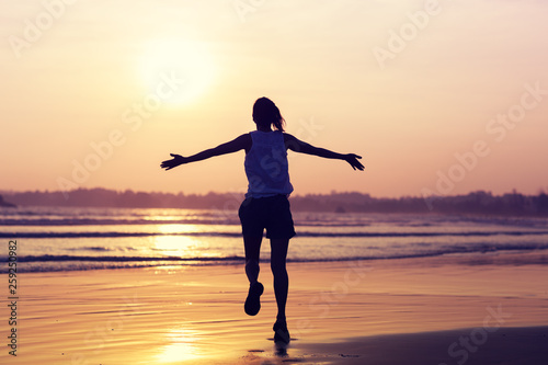 Fototapety, obrazy: Happy Free Woman at Sunset on the Beach.