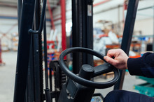 Man Driving A Forklift Truck I...