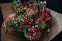 Beautiful Australian Native Flower Arrangement Wrapped Bouquet Eucalyptus, Protea, Bush Flowers, Carnation With Black Background